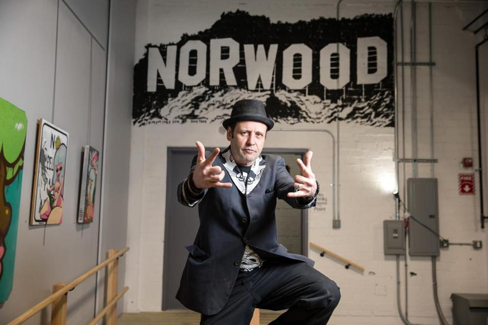 02/25/2018 NORWOOD, MA Artist and musician Dave Tree (cq) poses in front of a mural he painted in Percival Brewing Co. at the Norwood Space Center. (Aram Boghosian for The Boston Globe)